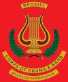The Redhill Corps of Drums & Band Logo
